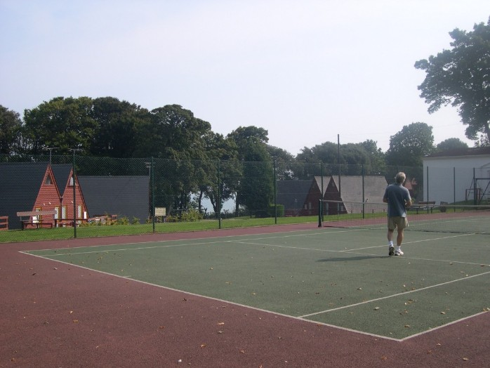 Playing tennis on the tennis court