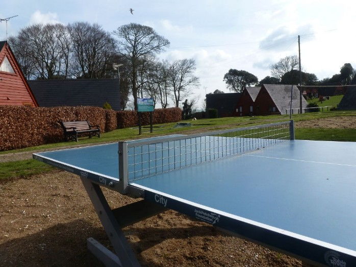View of the table tennis table with chalets behind